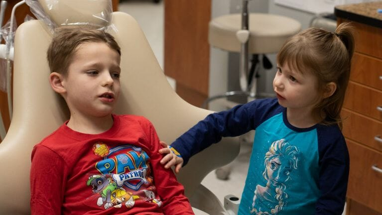 brother and sister at dentist