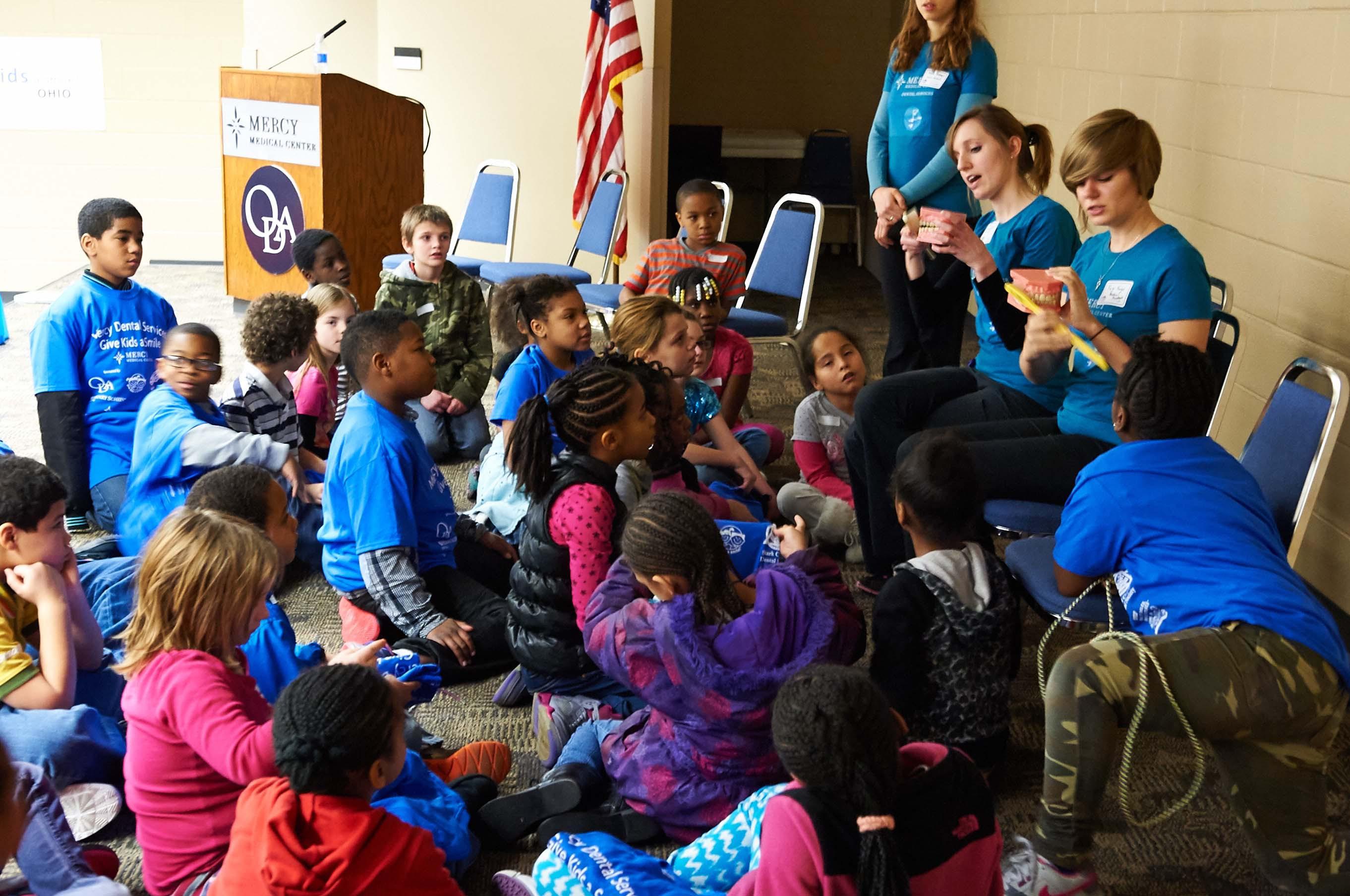 Children receive oral health care instruction