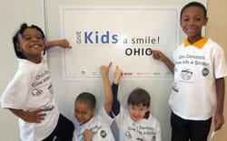 Kids at the 2014 Give Kids a Smile kick-off event